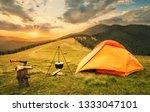 orange tent with a prepared... | Shutterstock . vector #1333047101