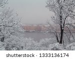 Foggy view over the river and the houses on the other side with snow on the trees. Stockholm Sweden