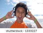 boy listening to music   Shutterstock . vector #1333227