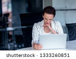 a young businesswoman sits... | Shutterstock . vector #1333260851