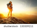 Hiker With Backpack Relaxing O...