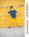 a five year old child in yellow ... | Shutterstock . vector #1333463897