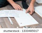 close up of men's hands collect ... | Shutterstock . vector #1333485017