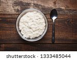 oatmeal in glass bowl with... | Shutterstock . vector #1333485044