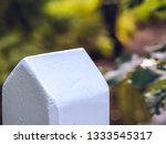 top of a white pillar in a park ... | Shutterstock . vector #1333545317