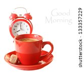 Cup of coffee and alarm clock on a white background. - stock photo