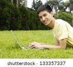 young man lying on with...   Shutterstock . vector #133357337