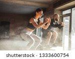 fit caucasian couple doing... | Shutterstock . vector #1333600754
