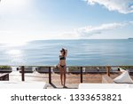 young lady posing on the beach... | Shutterstock . vector #1333653821