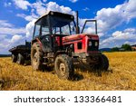 Red Old Tractor In Summer On...