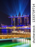 Small photo of SINGAPORE CITY, SINGAPORE - MARCH 3, 2019: Spectra Light and Water Show Marina Bay Sand Casino Hotel Downtown Singapore