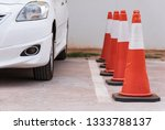 Small photo of Plastic signaling traffic cone in the parking car.Orange cones used to close off area for VIP customer.Special guest zone.Safety zoning site concept.