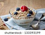 bowl of muesli and yogurt with... | Shutterstock . vector #133393199