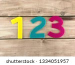 one two three numbers in wood... | Shutterstock . vector #1334051957