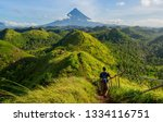 hiker with backpack looks at... | Shutterstock . vector #1334116751