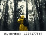 man in a yellow raincoat with a ... | Shutterstock . vector #1334177564