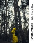 man in a yellow raincoat with a ... | Shutterstock . vector #1334177567