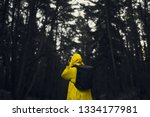 man in a yellow raincoat with a ... | Shutterstock . vector #1334177981