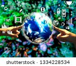 hand holding touch earth and... | Shutterstock . vector #1334228534