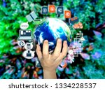 hand holding touch earth and... | Shutterstock . vector #1334228537