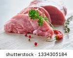 close up on slices of raw beef... | Shutterstock . vector #1334305184