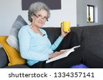 positive elderly lady suffering ...   Shutterstock . vector #1334357141