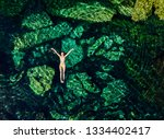 overhead shot of a attractive... | Shutterstock . vector #1334402417