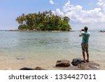 tourist man standing on the... | Shutterstock . vector #1334427011