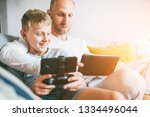 father and son game players... | Shutterstock . vector #1334496044