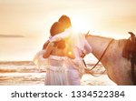 handsome couple walking with... | Shutterstock . vector #1334522384