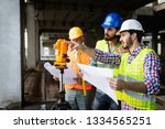 confident team of architects... | Shutterstock . vector #1334565251
