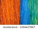multicolored woolen threads... | Shutterstock . vector #1334627867