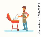 young man frying barbecue flat... | Shutterstock .eps vector #1334652491