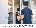 asian man accepting delivery... | Shutterstock . vector #1334739131