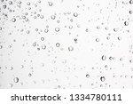 wet window glass with splashes...   Shutterstock . vector #1334780111