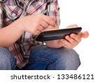 close up of a kid hands using... | Shutterstock . vector #133486121