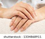 woman gets manicure procedure... | Shutterstock . vector #1334868911