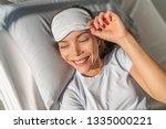 happy asian woman waking up... | Shutterstock . vector #1335000221