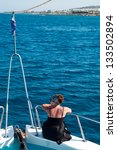 brunette woman on bow of yacht... | Shutterstock . vector #133502894