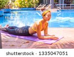 woman training yoga at sunset... | Shutterstock . vector #1335047051