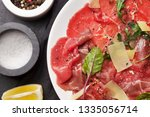 marbled beef carpaccio with... | Shutterstock . vector #1335056714