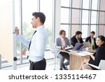 business executive delivering a ... | Shutterstock . vector #1335114467