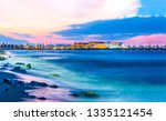 Sunset sea shore landscape. City sea shore sunset panorama. Sunset city sea shore view. Sunset sea shore panorama