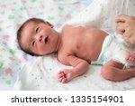 asian baby boy is wearing... | Shutterstock . vector #1335154901