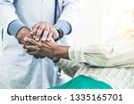 mature doctor talking and...   Shutterstock . vector #1335165701