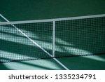 net of tennis court on green... | Shutterstock . vector #1335234791