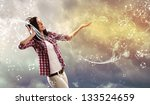 young girl listens to music.... | Shutterstock . vector #133524659