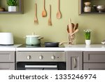 modern electric stove with... | Shutterstock . vector #1335246974
