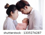 young asian mother and father...   Shutterstock . vector #1335276287