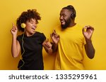 energized black male and female ... | Shutterstock . vector #1335295961